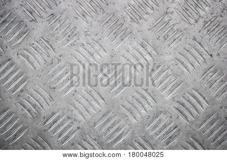 Texture of metal diamond plate closeup