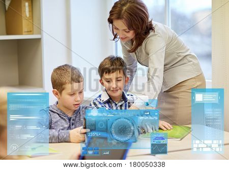 education, elementary school, learning and people concept - teacher helping kids with tablet pc computer in classroom over virtual screens projections