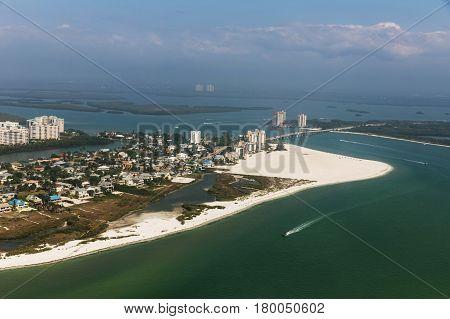 Aerial view to the large white sandy beach on the Estero Island Florida