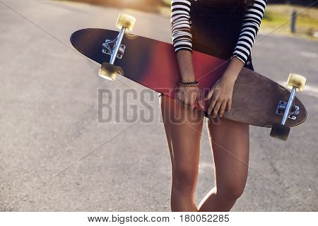 Girl with a long board close up