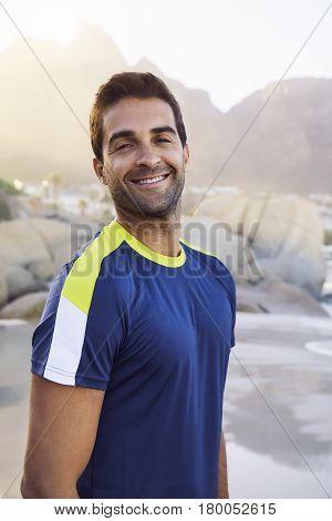 Handsome Stubble guy smiling on beach portrait