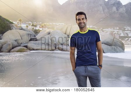 Handsome Happy guy standing on beach smiling