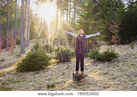 Active lifestyle - healthy lifestyle. Relaxing in the nature. Outdoor activities and meditating in wood. Unspoiled and healthy forest.