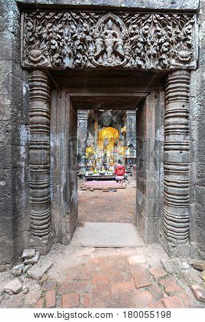 Champasak Laos - 23 January 2012: woman praying on Wat Phu temple at Champasak Laos