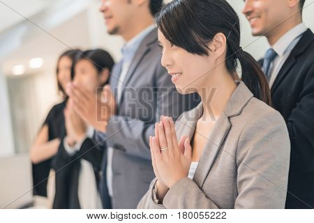 business people with thai greeting in office
