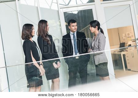 asian business people talk and chat