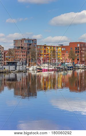 GRONINGEN, NETHERLANDS - APRIL 03, 2017: Apartment buildings with reflection in the water in Groningen, Holland