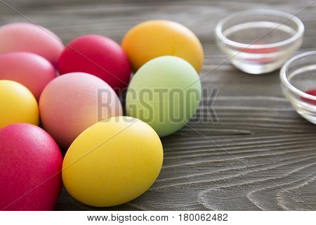 Colored Painted Eggs And Color Pigments. Celebrating Easter