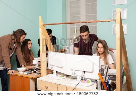 Team of young creative people in an office enviroment. Creativity and business. Start up company