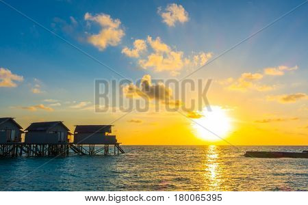 Beautiful sunset with  water villas  in tropical Maldives island