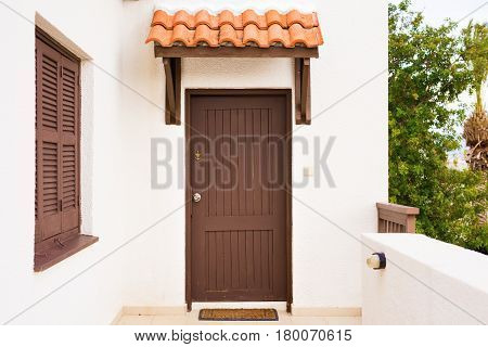 Wooden front door of a home. Front view.