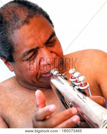 African american jazz musician blowing his flugelhorn.