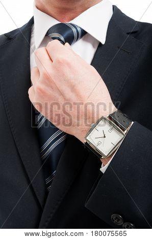 Close-up Of Elegant Gentleman Arranging His Tie