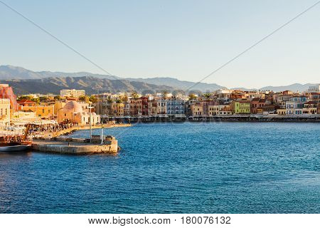 venetian habour of Chania with historical houses at sunny summer day, Crete, Greece