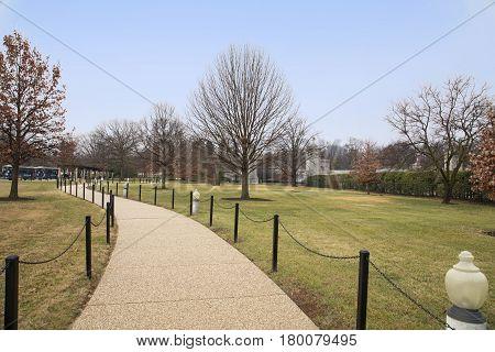 Arlington, USA - January 4, 2017: Pedestrian walkway at Arlington National Cemetery, Virginia.