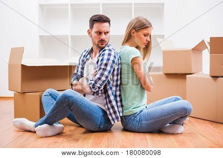 Young couple is moving in their new home. It's time for unpacking.