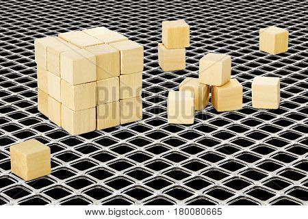 wooden cubes forming a bigger cube on mesh abstract creativity concept