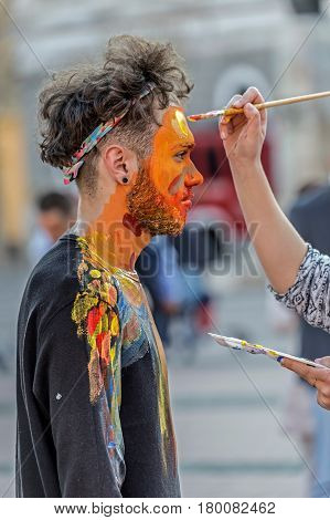 TIMISOARA ROMANIA - MARCH 31 2017: Face and body painting of a man. 3D art symbolizing on live at the street inside the CheckART Carnival organized by the City Hall Timisoara. Liberty Square.