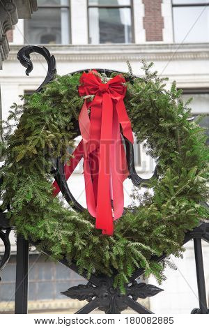 A green Christmas wreath with red bow