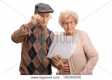 Surprised seniors looking at documents isolated on white background