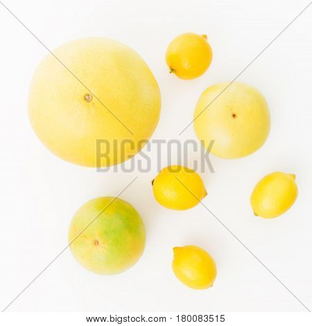 Pomelo and lemon, orange and sweetie on white background. Flat lay, top view. Food background