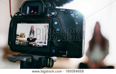 Young Female Vlogger On Camera Screen.