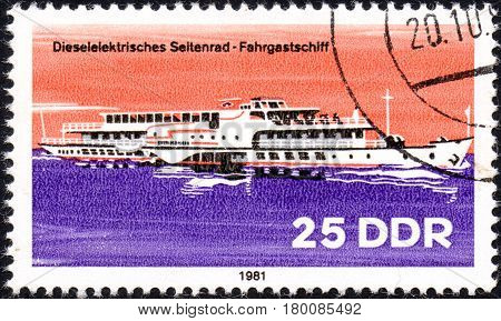 UKRAINE - CIRCA 2017: A postage stamp printed in DDR shows Tugboat River Boat circa 1981