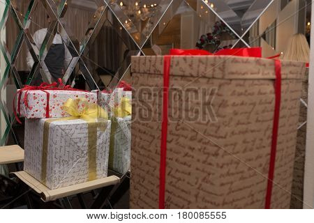 Three gift boxes wrapped in colorful paper, ribbon, bow, on white: for anniversary, new year, birth day
