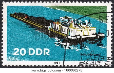 UKRAINE - CIRCA 2017: A postage stamp printed in DDR shows Barge with a cargo on the river circa 1981