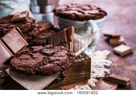 Round chocolate cookies with cracks. Selective focus.