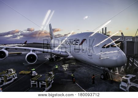 NEW YORK - DECEMBER 15: JFK International Airport sunsett with Airfrance Airbus A380 airplane on front, seen in Long Island, New York on December 15, 2016