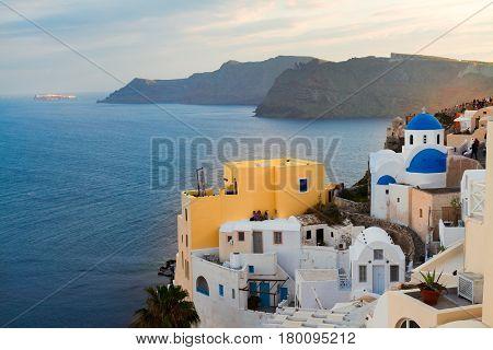 lanscape of Oia with blue church domes, volcano caldera and Aegan sea, beautiful details of Santorini island, Greece