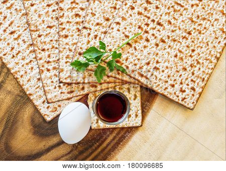 Traditional food and drinks - matzo, egg, green and wine for Jewish Passover celebration