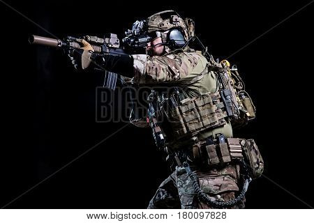 Spec ops soldier with flak jacket and on dark background