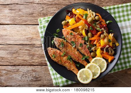 Roasted Red Mullet With Stewed Vegetables, Lemon And Greens Close-up. Horizontal Top View