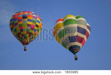 Colorful hot air balloons flying in sky poster