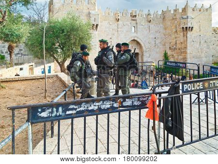 JERUSALEM, ISRAEL - DECEMBER 29, 2016: Police officers are on duty near Damascus Nachem Gate to old city of Jerusalem. They were built in 16th century and are a typical example of Muslim architecture