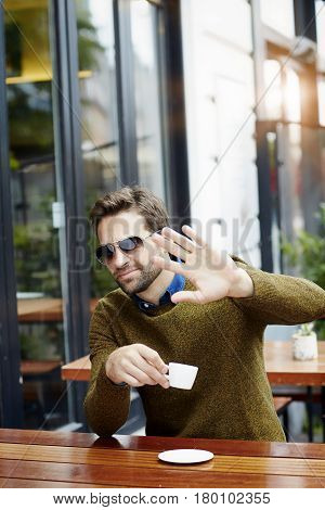 Hot Celebrity gesturing over coffee city life