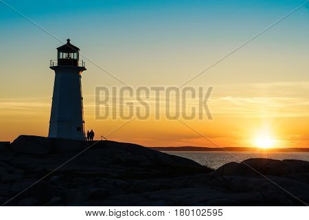 Peggy's Cove Lighthouse, Nova Scotia at sunset.