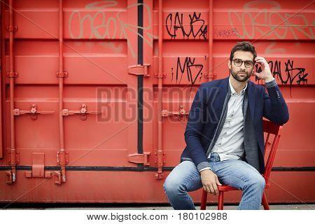Cargo container guy sitting fashion portrait  shot