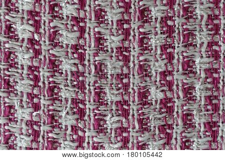 Close-up of uneven fabric with geometric pattern in pink and white