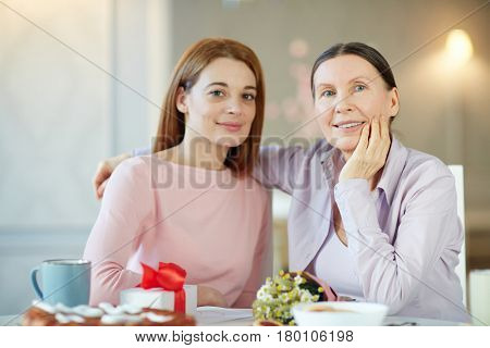 Attractive females looking at camera on family occasion
