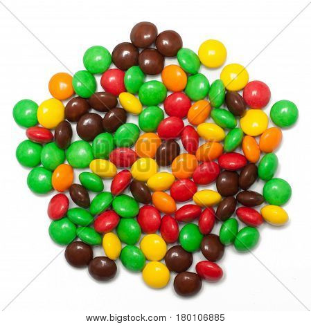 A pile of green brown red yellow and orange chocolate coated candy