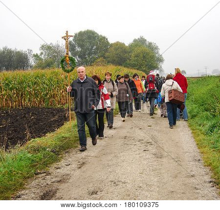Altoetting,Germany-October 2,2010: A group of pilgrims walks along a path in the bavarian countryside