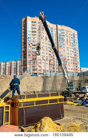 MOSCOW - MAR 27: Construction site workers on march 27, 2014 in Moscow, Russia. Urban construction is at a faster pace in Russia.