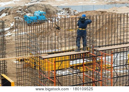 MOSCOW - APRIL 3: Construction site worker on april 3, 2014 in Moscow, Russia. Urban construction is at a faster pace in Russia.