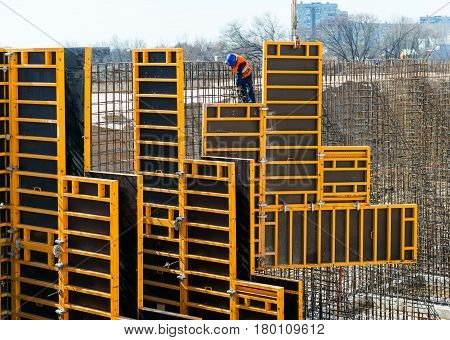 MOSCOW - APRIL 17: Construction site worker on april 17, 2014 in Moscow, Russia. Urban construction is at a faster pace in Russia.