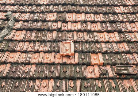 Closeup of old tiled roof. Background of old brick-tile. Pattern of dirty vintage tile roof