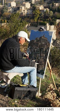 PROVENCE FRANCE- 15 FEB 2017: Artist paints beauty of Gordes the most beautifull city of the Provence France