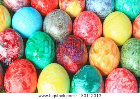 Many colorful Easter eggs in red, blue, green and yellow